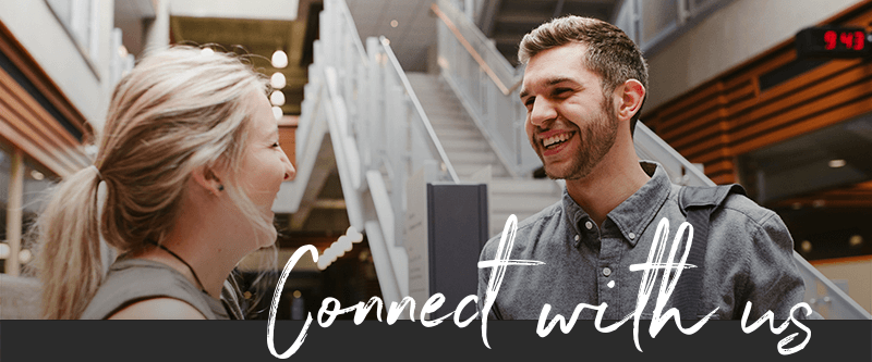 """Two young adults talking in the Roderick Mah Centre for Continuous Learning with the words """"Connect with us"""""""